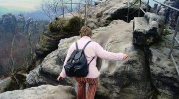woman walking on mountain top