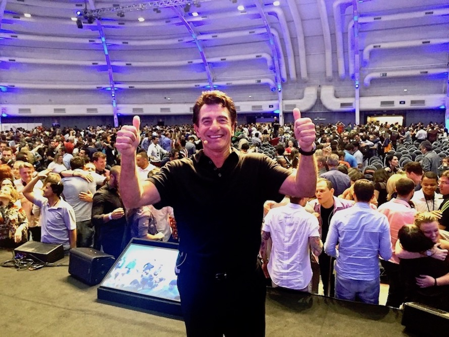 harv eker on stage two thumbs up