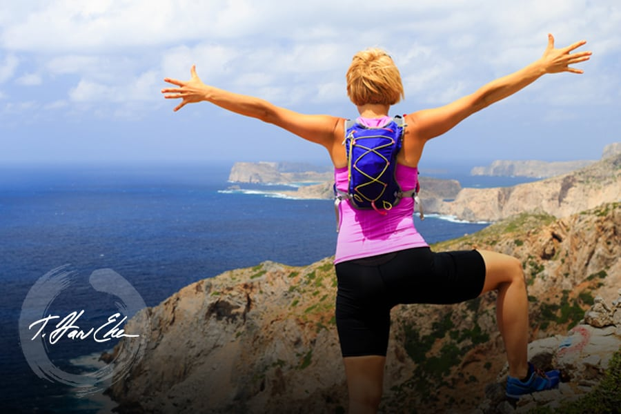 arms out mountain woman hiking