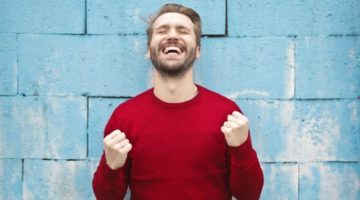 happy man wearing red sweater