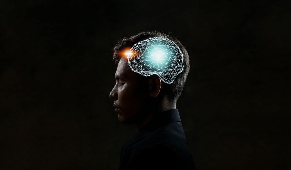 man with artwork of brain