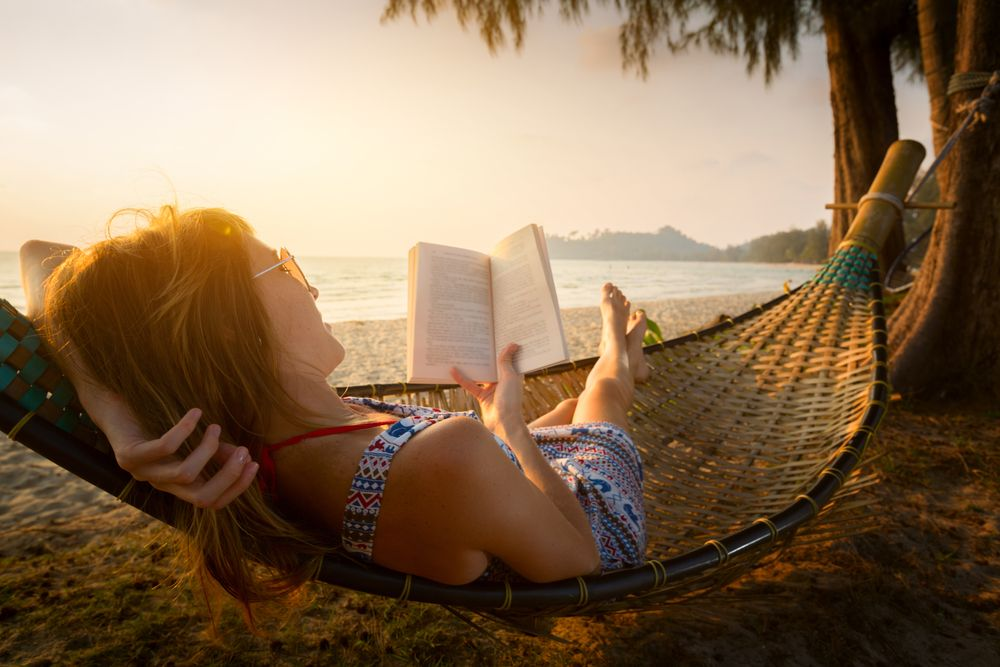 woman on digital detox reading on vacation